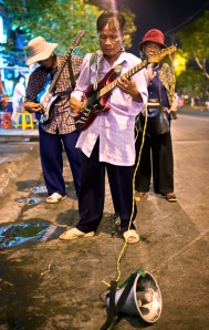 Street musicians perform in Viet Nam\'s largest Southern city.